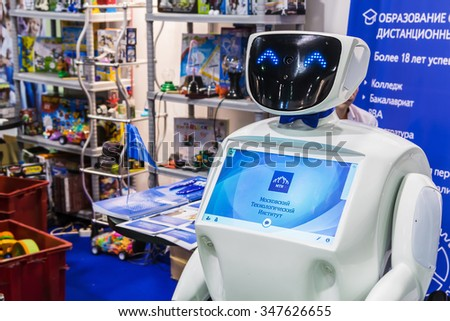 "Moscow, Russia, November 20, 2015: 3rd International Exhibition of Robotics and advanced technologies ""Robotics Expo"". Focus on the monitor of the robot - stock photo"