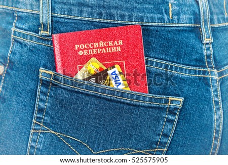 MOSCOW, RUSSIA - NOVEMBER 27, 2016: Russian passport and credit cards in back jeans pocket. Travel concept
