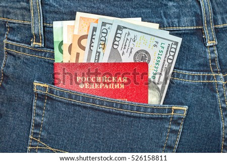 MOSCOW, RUSSIA - NOVEMBER 27, 2016: Russian passport, euro and dollar bills in the back jeans pocket. Money for travel and shopping