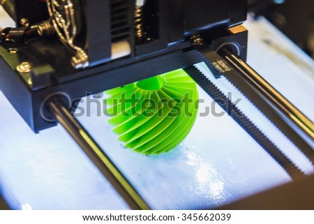 """Moscow, Russia, November 20, 2015: The 3rd International Exhibition of Robotics and advanced technologies """"Robotics Expo"""" in Moscow. Focus on a green plastic - stock photo"""