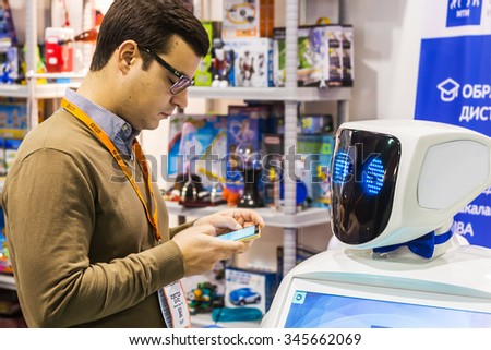 "Moscow, Russia, November 20, 2015: The 3rd International Exhibition of Robotics and advanced technologies ""Robotics Expo"" in Moscow. Focus on the eyes of the robot - stock photo"