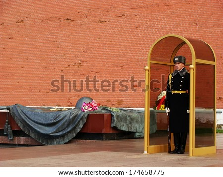 MOSCOW, RUSSIA-NOVEMBER 27: Unidentified guard stands at the Tomb of the Unknown Soldier on November 27, 2012 in Moscow, Russia. Tomb is dedicated to the Soviet soldiers killed during World War II. - stock photo