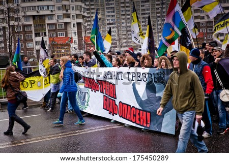 "MOSCOW, RUSSIA - NOVEMBER 4: Unidentified Russian nationalists during annual ""Russian March"" in Moscow, Russia on November 4, 2013. Nationalism becomes popular among Russians"