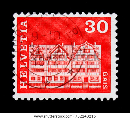 MOSCOW, RUSSIA - OCTOBER 3, 2017: A stamp printed in Switzerland shows Village square houses, Gais, Postal history motives and monuments serie, circa 1968