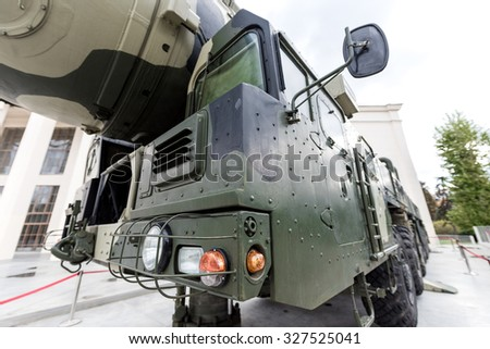 Moscow, Russia - October 12, 2015: Exhibition of achievements of national economy (VDNH). Details of military vehicles, exposed from the back side of the pavilion Space.