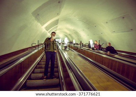 MOSCOW, RUSSIA - OCTOBER 1,2015: Moscow Metro station.It is one of busiest in whole world. Toned image. - stock photo