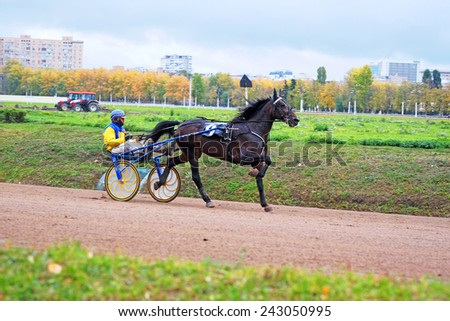 Moscow, Russia, October, 05, 2014: Racing at Moscow Hippodrome - stock photo