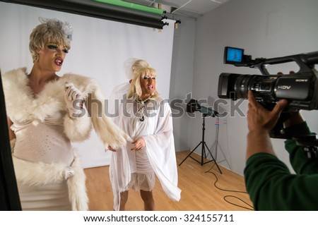 MOSCOW, RUSSIA - October 22, 2009 - Transgender LGBT group of people video shoot backstage in studio - stock photo