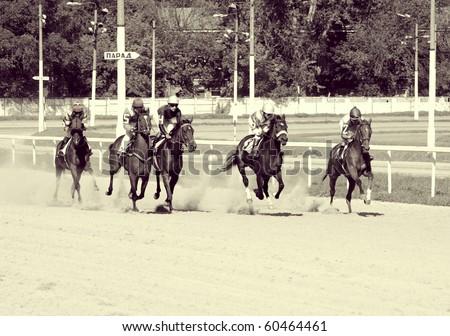 "MOSCOW, RUSSIA - SEP 5: The race for the prize ""Winter favorite"" for horses of 2-th years. Distance of 1600 meters Central hippodrome, September 5, 2010 in Moscow, Russia - stock photo"