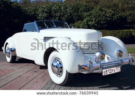 """MOSCOW, RUSSIA - SEPT 25: A 1937 Cord 812 Roadster is on display in the final stage of the championship competition for classic cars at the """"The Club Rally Classic Cars"""" on September 25, 2010 in Moscow, Russia. - stock photo"""