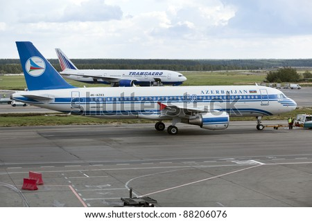 MOSCOW, RUSSIA - SEPT 17: Azal aircraft parks at Moscow airport Domodedovo on Sept. 17, 2011. Azerbaijan Airlines is the national carrier of Azerbaijan with a main base in the Baku International Airport.