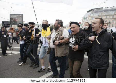 MOSCOW , RUSSIA - SEPT 15. Tens of thousands of opposition supporters have marched through Moscow in the first major protest against President Putin in three months on September 15, 2012, Moscoww - stock photo