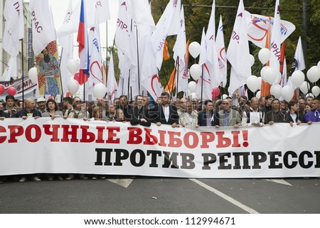 MOSCOW , RUSSIA - SEPT 15. Tens of thousands of oppositionist marched through Moscow in  against President Putin. Nemtsov  is  Russian politician between protestant. on September 15, 2012, Moscow - stock photo