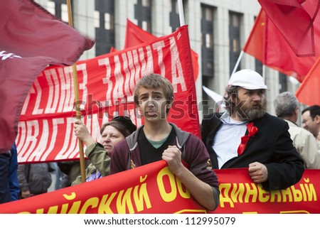 MOSCOW , RUSSIA - SEPT 15. Tens of thousands of oppositionists marched through Moscow in protest against President Putin. Anarchists take part in rally.  on September 15, 2012, Moscow - stock photo