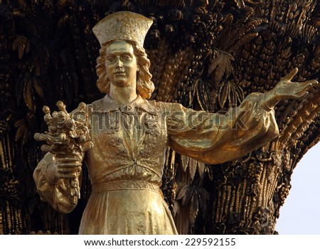 MOSCOW, RUSSIA - SEPT 20, 2014: Woman symbolizing Estonia - part of the fountain Friendship of Nations (1954), All Russian Exhibition Center - stock photo