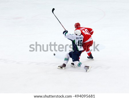 MOSCOW, RUSSIA - SEPTEMBER 27, 2016: A. Bulyansky (19) vs V. Sorokin (40) during hockey game Spartak vs Ugra on Russia KHL championship on November 27, 2016, in Moscow, Russia. Ugra won 3:2