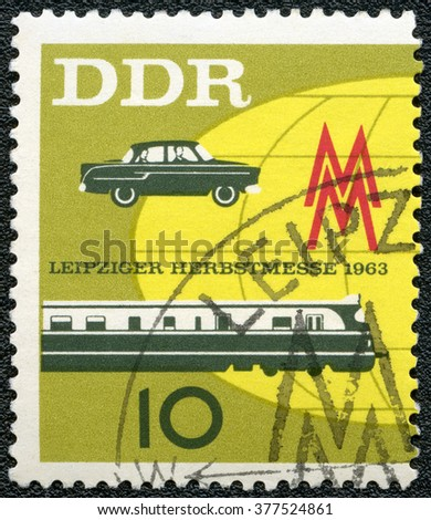 MOSCOW, RUSSIA - SEPTEMBER 20, 2014: A stamp printed in GDR Germany shows car and train, Issued to publicize the 1963 Leipzig Fall Fair, 1963 - stock photo