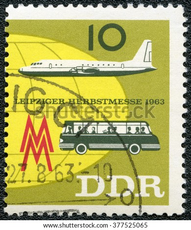 MOSCOW, RUSSIA - SEPTEMBER 20, 2014: A stamp printed in GDR Germany shows plane and bus, Issued to publicize the 1963 Leipzig Fall Fair, 1963 - stock photo
