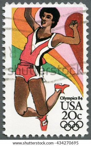 MOSCOW, RUSSIA - SEPTEMBER 20, 2014: A stamp printed in USA shows Sportsman, Long Jump, Summer Olympics Los Angeles, 1984 - stock photo