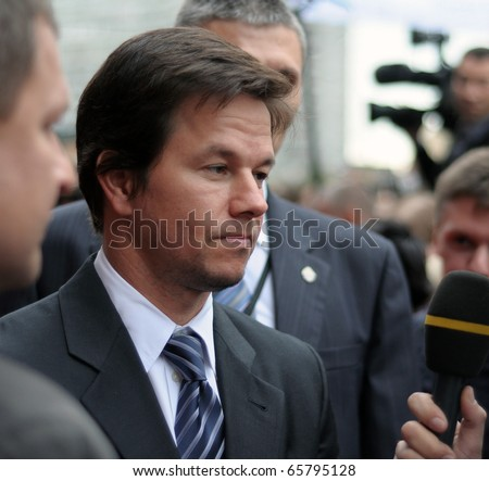 MOSCOW, RUSSIA - SEPTEMBER 12: Actor Mark Wahlberg arrives at the premiere for the film 'The Other Guys' in Moscow on September 12, 2010, Russia. - stock photo