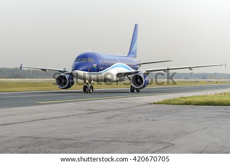 MOSCOW, RUSSIA - SEPTEMBER 26, 2014:  Airbus A320 Azerbaijan Airlines taxiing after landing at Domodedovo International airport. - stock photo