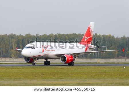MOSCOW, RUSSIA - SEPTEMBER 26, 2014: Airbus A319-111 Vim Airlines taxiing. Plane makes taxiing on taxiway Domodedovo International Airport. - stock photo