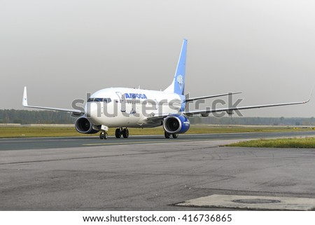 MOSCOW, RUSSIA - SEPTEMBER 26, 2014: Alrosa airlines Boeing-737 taxiing. Plane makes taxiing on taxiway Domodedovo International Airport. - stock photo