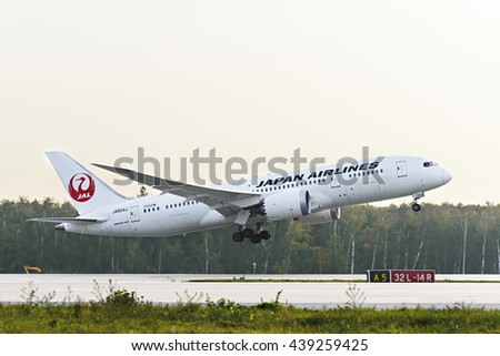 MOSCOW, RUSSIA - SEPTEMBER 26, 2014: Japan airlines JAL Boeing 787 Dreamliner taking off at Domodedovo international airport. - stock photo