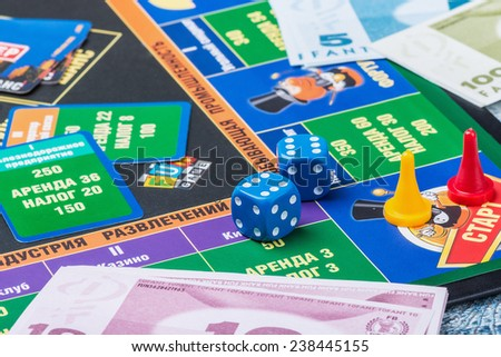 Moscow, Russia - September 11, 2014: Monopoly game on the table. Monopoly game in Russian, a board game in the genre of economic strategy for two or more people. - stock photo