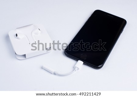 MOSCOW, RUSSIA - SEPTEMBER 29, 2016: new Apple Iphone 7 and EarPods with lightning 3.5mm adapter for headphones.