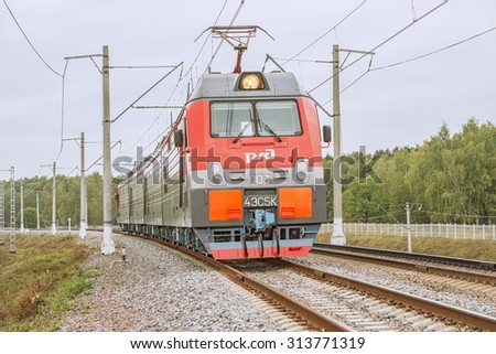Moscow, Russia - September 3, 2015: New modern four-section electric locomotive approaches to the station. EXPO 1520 railway exhibition in Cherbinka. - stock photo