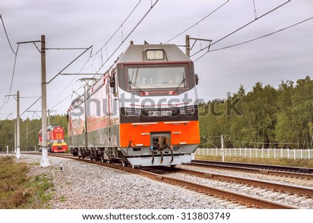Moscow, Russia - September 3, 2015: New modern two-section electric locomotive approaches to the station. EXPO 1520 railway exhibition in Cherbinka. - stock photo