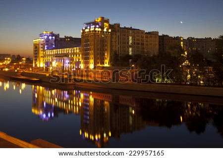 MOSCOW, RUSSIA - SEPTEMBER 13, 2012: The house on the Bersenevskaya embankment at night. Moscow - stock photo