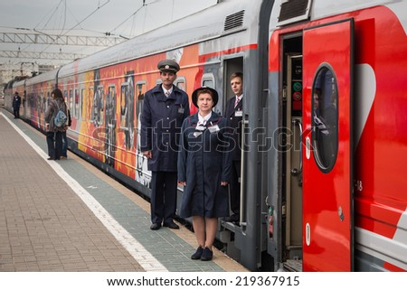 MOSCOW, RUSSIA, SEPTEMBER, 23: Train Conductors. VGIK 95 (Gerasimov Institute of Cinematography) Tour. September, 23, 2014 at Yaroslavsky railway station in Moscow, Russia - stock photo