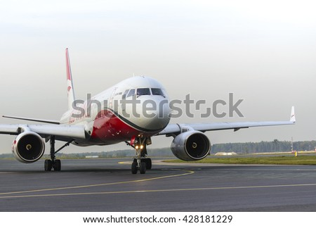 MOSCOW, RUSSIA - SEPTEMBER 26, 2014:  Tupolev Tu-204 RA-64049 Red Wings taxiing for take off at Domodedovo international airport - stock photo