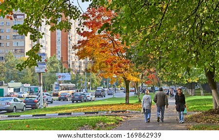 Moscow, Russia - September 18, 2013:Typical street of Moscow in autumn. Cars, hurrying people and the beauty of trees in autumn.  - stock photo