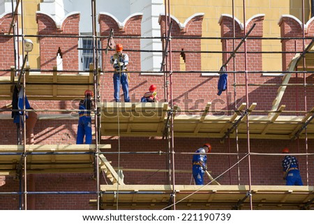 MOSCOW, RUSSIA - SEPTEMBER 20: View of renovation of Moscow kremlin wall on 20 of september 2014 in center of Moscow, Russia - stock photo