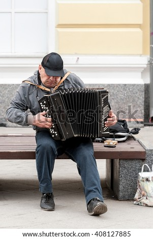 MOSCOW, RUSSIAN FEDERATION - APRIL 19: A street musician plays the accordion. April 19, 2016, Klimentovskiy lane, Moscow, Russia . - stock photo