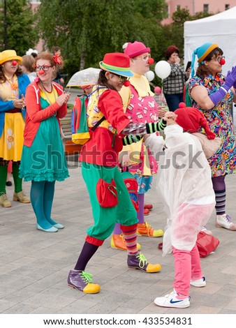 "MOSCOW, RUSSIAN FEDERATION - JUNE 5: Adults, children and clowns resting at festival ""Red"". June 5, 2016, Bauman Garden, Moscow, Russia."