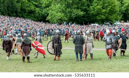 MOSCOW, RUSSIAN FEDERATION - JUNE 12, 2016: Men before battle in Vikings suits 13-14 centuries. Helmets, chain mail, armors, shields, edged weapon, hand made clothing. Historical reconstruction.