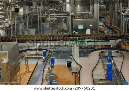 Moscow, Russian Federation March 07, 2015: Plastic water bottles on conveyor or water bottling machine - stock photo