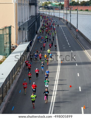 MOSCOW, RUSSIAN FEDERATION - SEPTEMBER 25, 2016: Moscow Marathon, symbol of the end of war and the beginning of peace. Athletes in the historic city center. Sofiyskaya embankment.