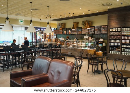 MOSCOW - SEP 24: Starbucks cafe interior in Sheremetyevo airport on September 24, 2014. Starbucks Corporation is an American global coffee company and coffeehouse chain based in Seattle, Washington - stock photo