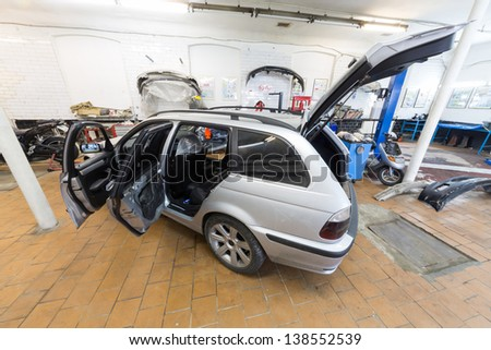 MOSCOW - SEP 21: The car is in the repair on car repair shop Avtostandart on September 21, 2012 in Moscow, Russia. - stock photo