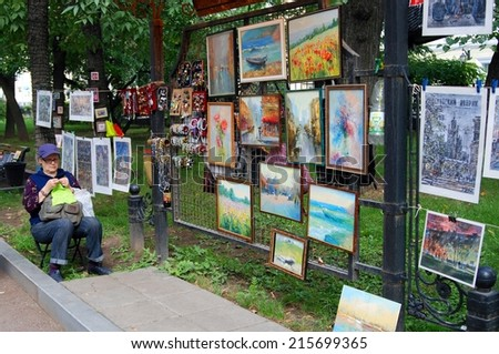 MOSCOW - SEPTEMBER 06, 2014: A souvenir seller portrait. Moscow City Day celebration in Moscow city center.