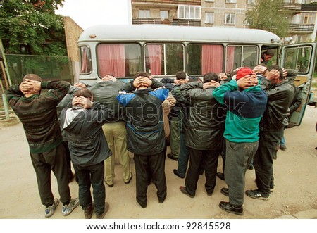 MOSCOW - SEPTEMBER 20: After making a mass arrest of Chechen men and women at a warehouse complex, Moscow police take them by bus to a central holding facility for questioning on September 20, 1999 in Moscow