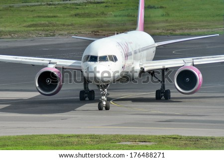 MOSCOW - SEPTEMBER 05: Airplane in airport Domodedovo in September 05, 2012 in Moscow. The airplane Boeing 757-230 of VIM airlines Reg RA-73017  - stock photo