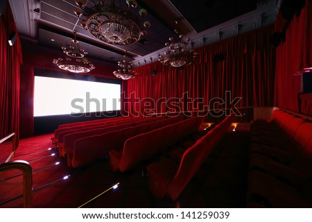 MOSCOW - SEPTEMBER 4: Big hall with large beautiful chandeliers in cinema in GUM, on September 4, 2012 in Moscow, Russia. Comfortable big hall of cinema in GUM has 70 seats. - stock photo