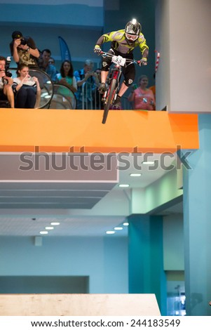 MOSCOW � SEPTEMBER 13: biker on mountain bike jumping at DownMall contest, September 13, 2014 in Moscow, Russia - stock photo