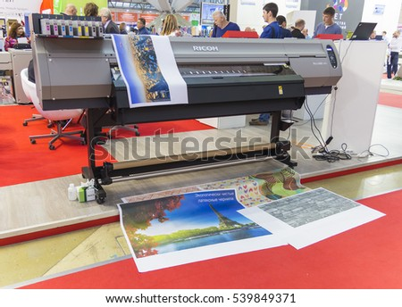 MOSCOW-SEPTEMBER 29, 2016: Business people are watching large format printer brand RICON at the International Trade Fair Advertising
